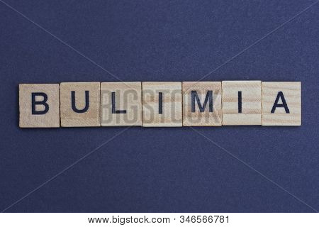 Gray Word Bulimia From Small Wooden Letters On A Black Table