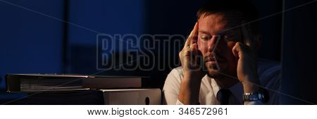 Portrait Of Man Realizing Amount Of Biz. Exhausted Businessman Sitting Indoors And Holding Aching He