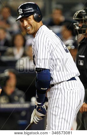 BRONX, NY - APR 19: New York Yankees shortstop Derek Jeter (2) reacts at the plate during the second inning against the Minnesota Twins on April 19, 2012 at Yankee Stadium.