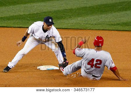 BRONX, NY - APR 15: New York Yankees shortstop Derek Jeter (2) tags out Los Angeles Angels left fielder Vernon Wells (10) during the fourth inning on April 15, 2012 at Yankee Stadium.