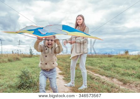 Woman Mother Child, Little Son Boy 4-5 Years Old, Autumn Park, Launching Toy Kite, Playing, Fun, Emo
