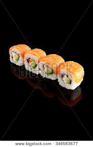 Fresh Delicious Philadelphia Sushi With Avocado, Creamy Cheese, Salmon And Masago Caviar Isolated On