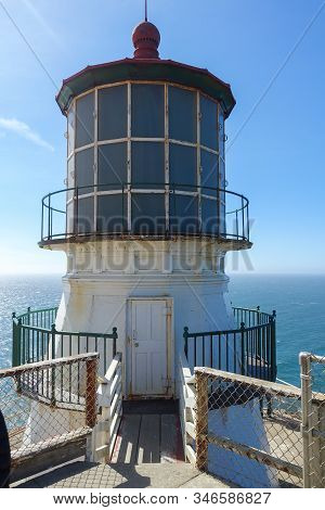 Vertical Image Of The Point Reyes Lighthouse In Northern California With The Pacific Ocean In The Ba