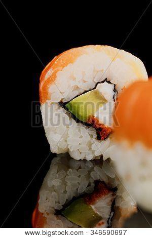 Selective Focus Of Fresh Delicious Philadelphia Sushi Piece With Avocado, Creamy Cheese, Salmon And
