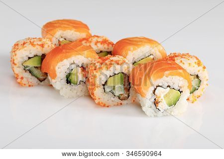 Delicious Philadelphia And California Sushi With Salmon And Masago Caviar On White Background