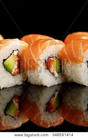 Close Up View Of Fresh Delicious Philadelphia Sushi With Avocado, Creamy Cheese, Salmon And Masago C