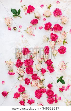 Arrangement Of Flowers. Background Roses Scattered On A Vintage Surface. Top View, Blank Space