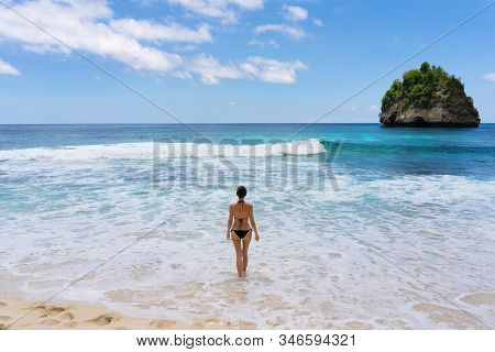 Young Woman On The Beach.  White Sand And Crystal Sea Of Tropical Beach.