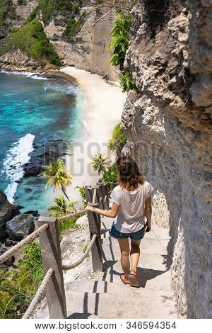 Young Woman On The Stairway To The Beautiful Diamond Beach, Nusa Penida Island