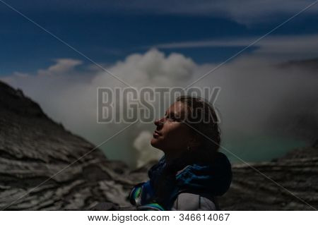 Portrait Of Traveler Near Ijen Volcano Crater At The Night. East Java, Indonesia