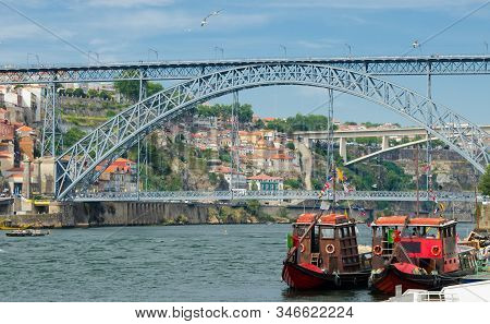 Portugal, Porto, Wooden Red Boats With Wine Barrels On Douro River Close Up, Wooden Boats With Port