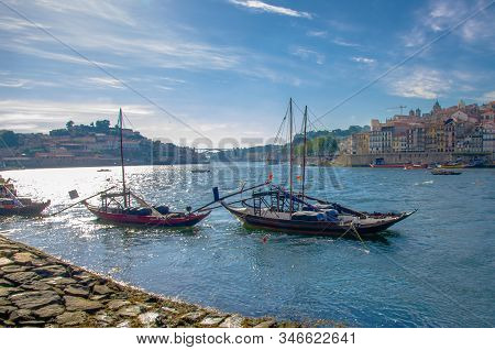 Portugal,  Porto, A Group Of Wooden Boats With Wine Port Barrels Close Up On Douro, Porto By River,
