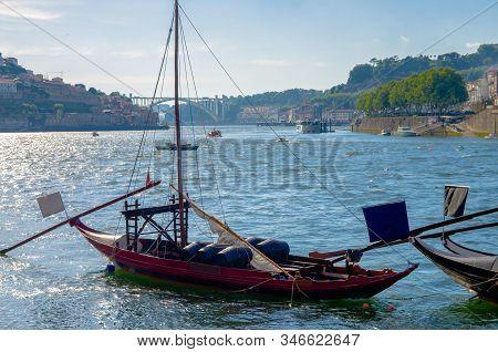 Portugal,  Porto, Red Wooden Boat With Wine Port Barrels Close Up On Douro, Porto By River,  Porto I