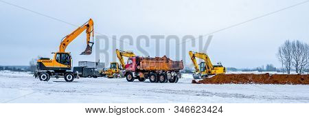Construction Truck Tipping Dumping Gravel On Road Construction Site, Tip Truck And Ripper At Work Pr
