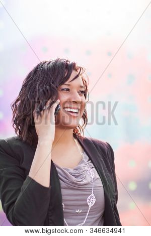 A shot of a happy African American businesswoman talking on the phone