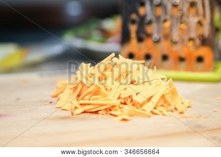 Cheddar Cheese, Grated Cheddar Cheese On Board
