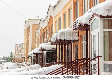 Snow Covered Townhouses, Fir Trees Grow Behind Townhouses, Selective Focus