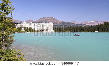 Lake Louise Canada- Jul 5, 2018: Fairmont Chateau And A Canoe At Lake Louise In Banff National Park