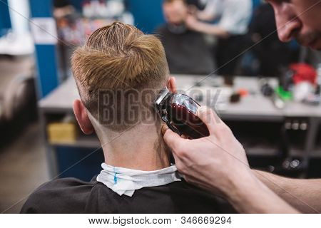 Close Up Shot Of Man Getting Trendy Haircut At Barber Shop. Male Hairstylist Serving Client, Making
