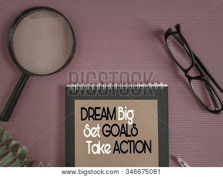 Inspirational And Motivational Quote Of Dream Big Set Goals Take Action On Notepaper In Vintage Back