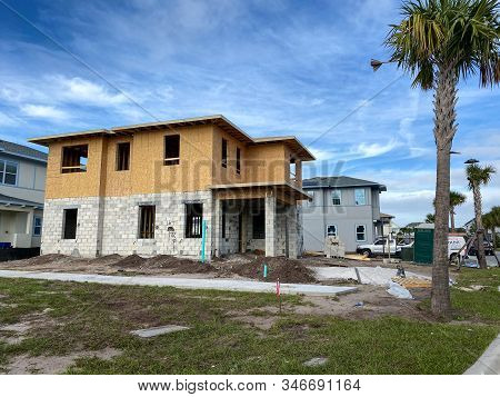 Orlando, Fl/usa - 12/25/19: A New Home That Is Under Construction With Constuction Materials In The