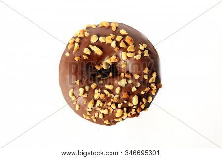 chocolate Donut with peanuts. isolated on white. room for text. clipping path. People world wide enjoy donuts. Enjoy a Donut today.