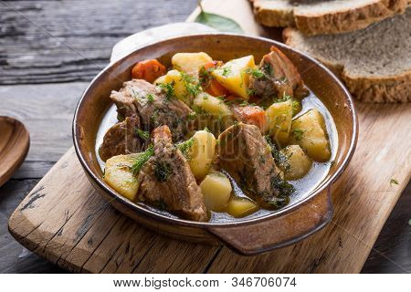 Potato Stew. Irish Dinner. Beef Meat Stewed With Potatoes, Carrots And Soda Bread On Wooden Backgrou