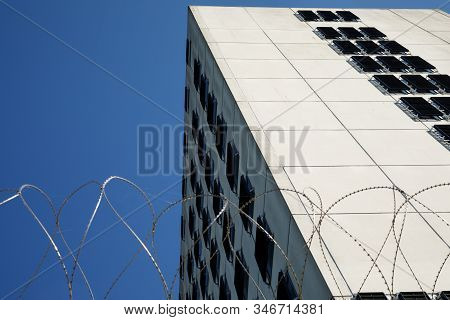 Amsterdam, Netherlands June 29, 2019: A Prison Building Named Bijlmer Bajes With Barbed Wire Fence.