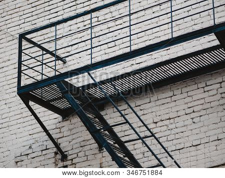 Facade With Fire Rescue Steel Ladder Of Old House In Moscow, Russia. Fire Escape From Steel Metalwor