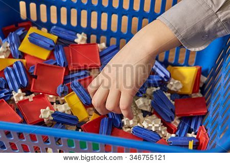 Close Up Of Child Hands Playing With Colorful Constructor. Toddler Having Fun And Building Out Of Br