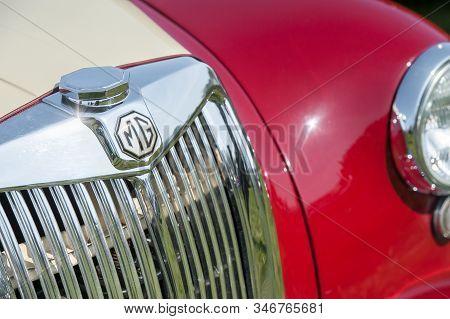 Rushmoor, Uk - April 19: Closeup Of A British Made Mg Sports Car And Vehicle Badge In Rushmoor, Uk -