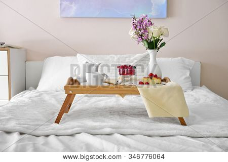 Tray Table With Tasty Breakfast On Bed
