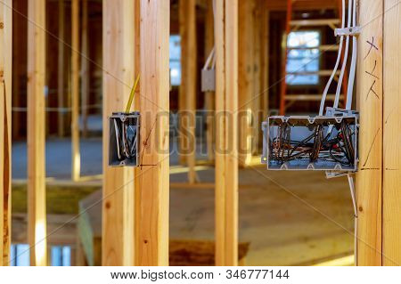 Electrical Socket Boxes With Wires Of Wooden Beams In A Wall Under Construction Unfinished Frame