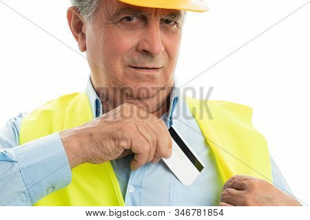 Closeup Of Trustworthy Architect Man Hiding Credit Card Inside Chest Pocket Of Shirt Isolated On Whi