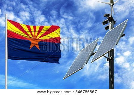 Solar Panels On A Background Of Blue Sky With A Flagpole And The Flag State Of Arizona