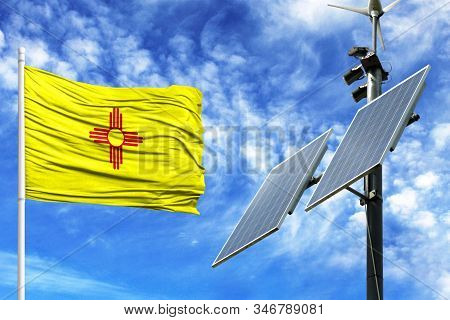 Solar Panels On A Background Of Blue Sky With A Flagpole And The Flag State Of New Mexico