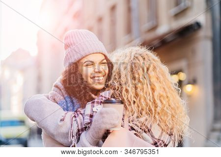 Happy Brightful Positive Moments Of Two Stylish Girls Friends Hugging On Street. Closeup Portrait Fu