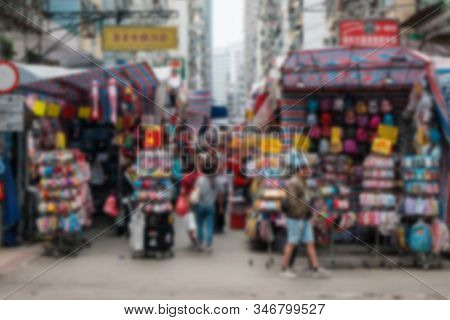 Abstract, Blurred  Image Of People On Street Market (ladie`s Market) In Hong Kong