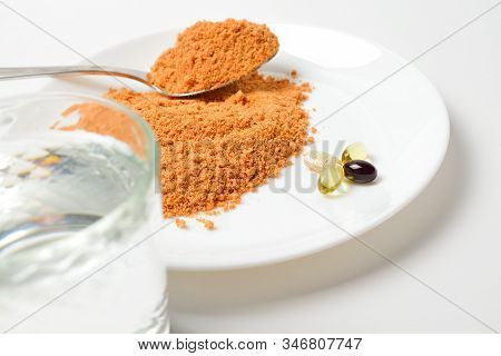 Tomato Protein Soup Powder On A Spoon. Meal Replacement. Dry Soup. Multivitamins, Astaxanthin, Fish