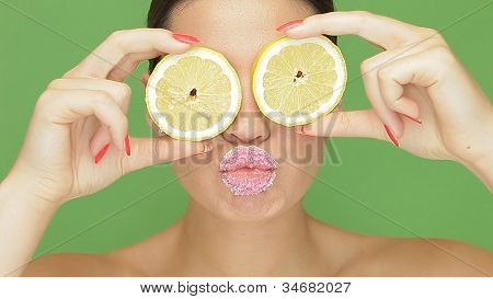 Woman With Lemon Eyes And Puckered Lips