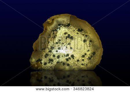 Close Up Of A Slice Agate Gemstone On Dark Background, Detail
