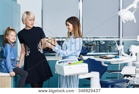 Adorable Little Girl Looking Into Medic Mouth While Playing A Doctor With Female Pediatric Dentist I