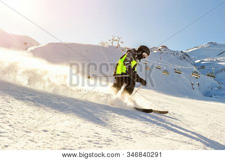Child Teenager Boy Skiing Fast In Mountains. School Boy Having Fun Running Downhill Slope At Alpine