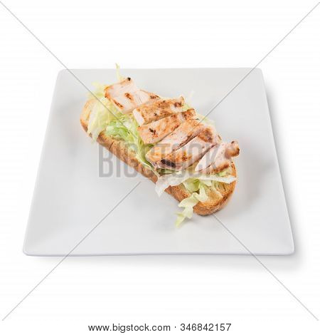 A Caesar Salad Toast With Lettuce And Chicken Slices