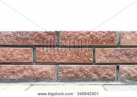 Straight Lines Of New Fresh Brickwork Wall And Cincrete Foundation Isolated On White Background. Mod