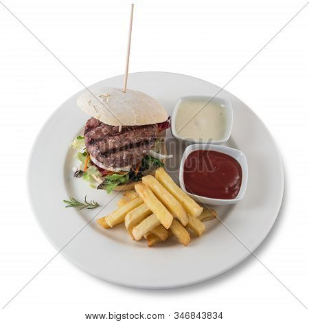 A Hamburger With Fries On A Plate On A White Background