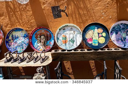 Puebla, Mexico  March, 2017: Local Quirky Antique Shop Display Featuring Many Traditional Mexican Ho