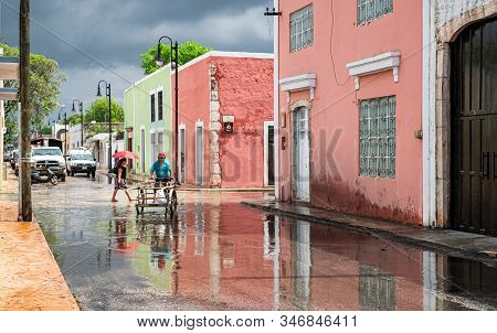 Valladolid, Yucatn, Mexico - April 19, 2017: People Going About Their Life After Torrential Rains In
