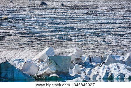 Icebergs Calving Off Grinnell Glacier In Montana Wilderness