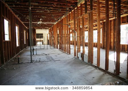Home or Building Demolition. Remodeling of a Home or Office Building. An empty building with the walls and appliances removed. Bare Wood Frame inside an old building during a remodeling job.